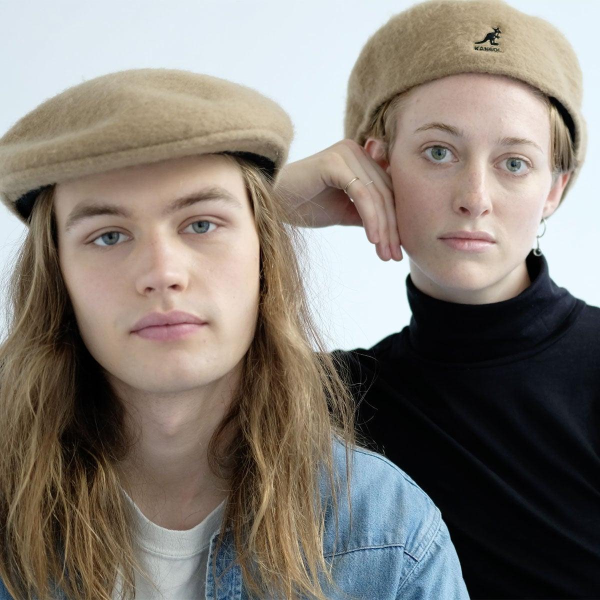 Two models wearing Kangol Woollux 504 hats